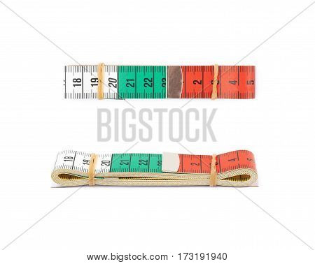 Folded dieting tape measure isolated over the white background, set of two different foreshortenings