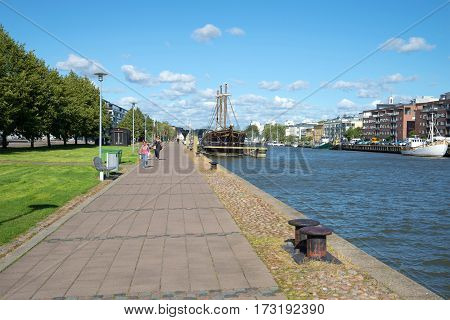 TURKU, FINLAND - AUGUST 27, 2016: Sunny August day on the embankment of the river Aura