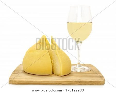 A photo of tetilla, a traditional Spanish soft cow milk cheese, with a slice cut off, and a glass of white wine, on white background