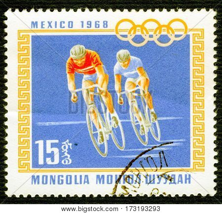 MONGOLIA - CIRCA 1968: Postage stamp printed in Mongolia  with a picture of a cyclists, from the series