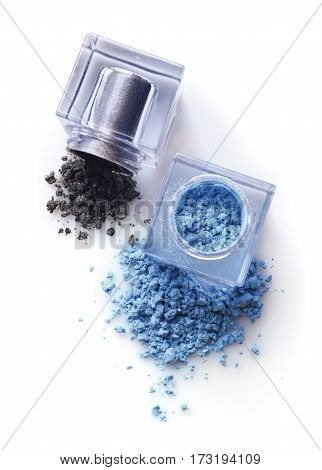Jars Of Blue And Gray Powder Eyeshadow For Make Up As Sample Of Cosmetic Product