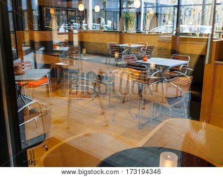 Modern Classical Design Coffee Shop Cafe Restaurant Interior via Blurred Window Image