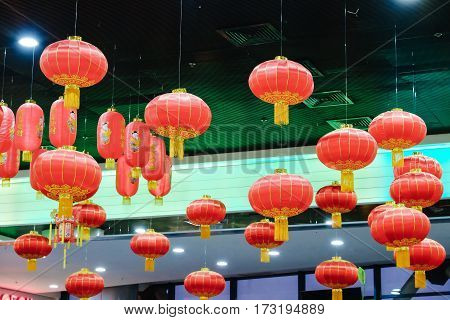 Chinese red lanterns are hanging at the Mall