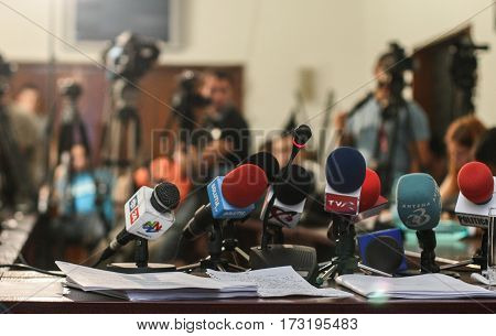 Bucharest Romania July 14 2009: Microphones and video cameras in the background in a press conference in Bucharest.