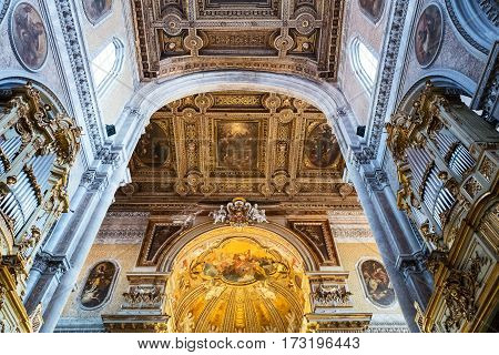 Naples, Italy - August 4, 2015:  Upward view of the paintings and decorations of the Duomo nave