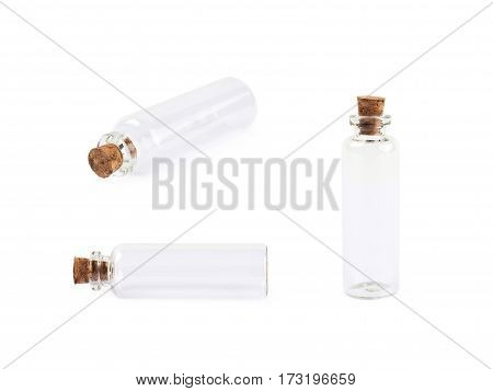 Single empty tiny glass bottle with a cork isolated over the white background, set of three different foreshortenings