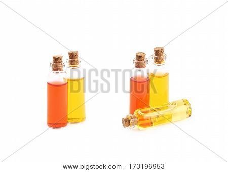 Composition of a few tiny glass vial bottles filled with the colored liquids, composition isolated over the white background, set of two different foreshortenings