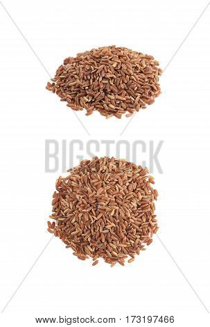 Pile of brown rice grains isolated over the white background, set of two different foreshortenings