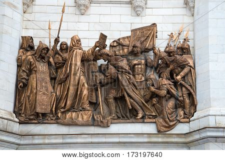 MOSCOW, RUSSIA - APRIL 14, 2015: the Blessing of the Russian soldiers before the battle of Kulikovo. The bas-relief on the wall of the Cathedral of Christ the Savior