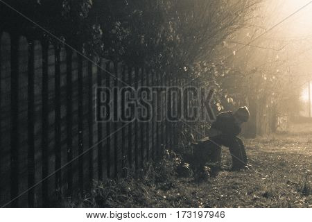 Boy Walking In The Evening In The Village In The Mist
