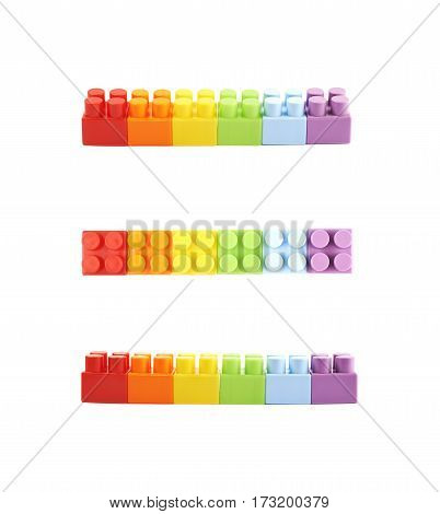 Line of plastic construction and rainbow colored toy bricks isoalted over the white background, set of three different foreshortenings