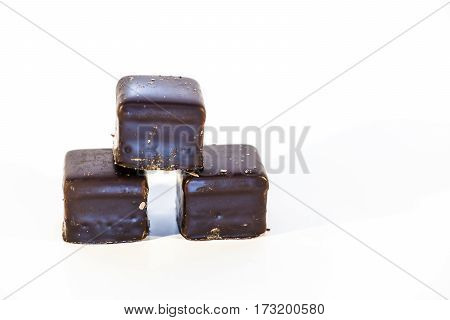 Lebkuchen cookies filled with marzipan, apricot jelly, covered with icing of dark chocolate