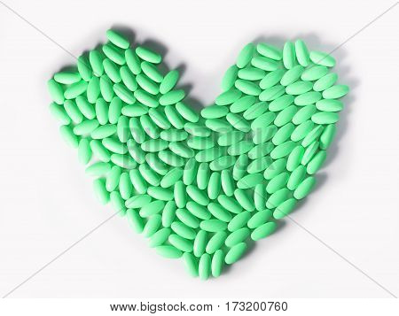 Close up group of drugs or medicines arrange in heart shape isolated on white