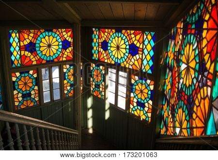 TBILISI GEORGIA - JANUARY 3 2016: Interior of an old house with mosaic windows in the old town of Tbilisi Georgia.