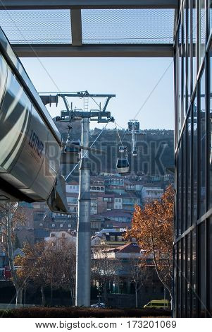 TBILISI GEORGIA - JANUARY 3 2016: Tbilisi aerial cable car one of modern sightseengs of the city connecting Rike Park on the left bank of the Mtkvari (Kura) river with Narikala Fortress Georgia.
