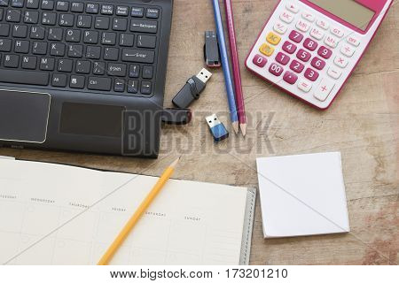 computer with flash memory and notebook planner for financial on office desk