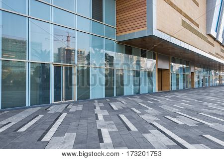 glass building exterior with brick pavement,shenzhen,china .