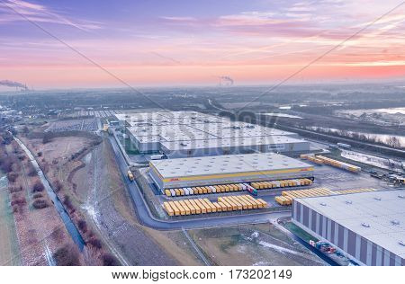 RHEINBERG / GERMANY - JANUARY 29 2017 : The Amazon distribution centre with it's connection to DHL and HAVI enjoying the sunrise, aerial