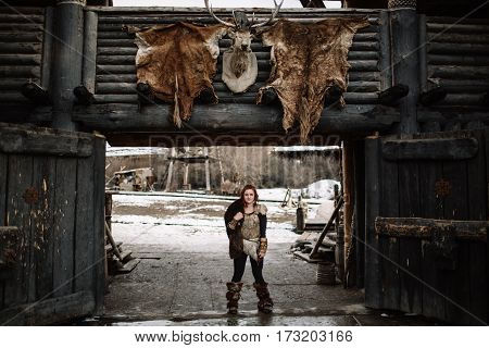 The Girl Dressed In A Viking Outfit.