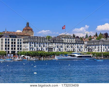 Lucerne, Switzerland - 8 May, 2016: people in boats on Lake Lucerne, buildings along the lake. Lucerne is a city in central Switzerland, it is the capital of the Swiss canton of Lucerne and the capital of the district of the same name.