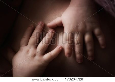 soft gentle fingers and hands newborn baby close-up