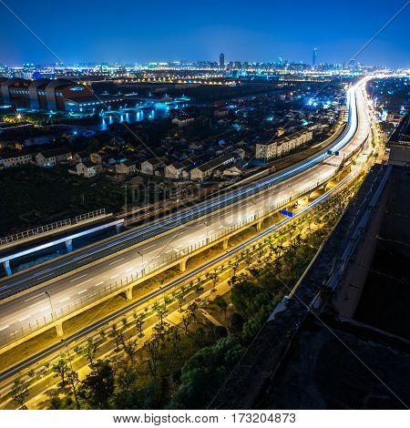 traffic light trails at Night in Shenzhen China.