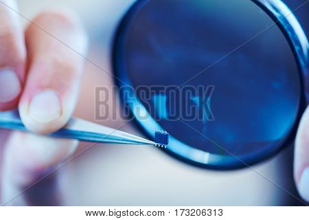 microchip with tweezers