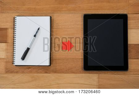 Diary with digital tablet on table