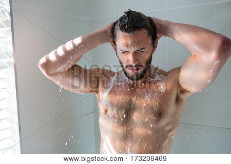 Man taking a bath in bathroom at home