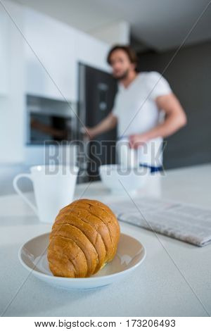 Close-up of croissant in plate at kitchen