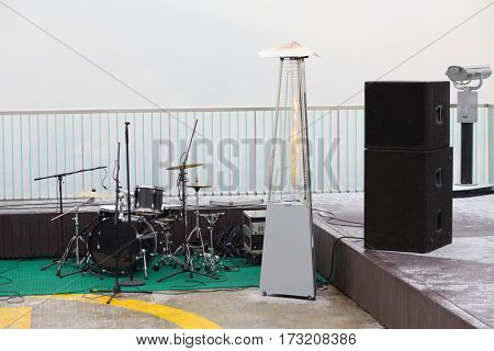 Musical instruments and lighting on overcast foggy day on rooftop