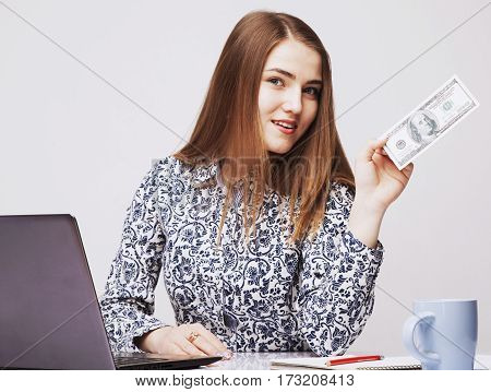 Best motivation is money.Hhappy businesswoman working in the office for the money. (perspective enrichment freedom employment career concept)