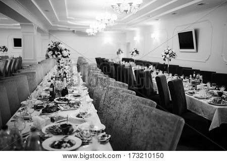 Wedding Reception Of Table And Chairs. Black And White Photo.