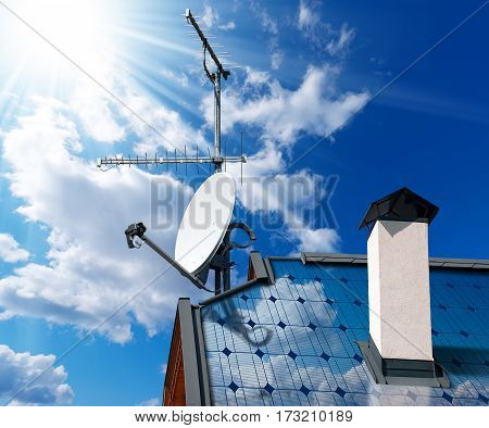 Close-up of a house roof with solar panels and satellite dish with antenna TV on a blue sky with clouds and sun rays