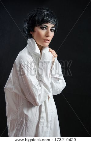 girl in a white shirt with heaved up a collar
