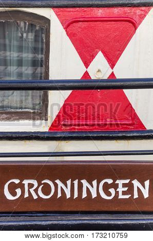 City name on an old ship in Groningen The Netherlands