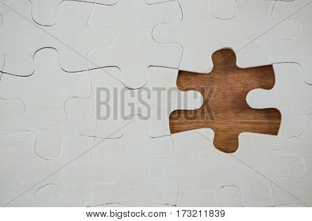 Close-up of jigsaw puzzle with one piece separately