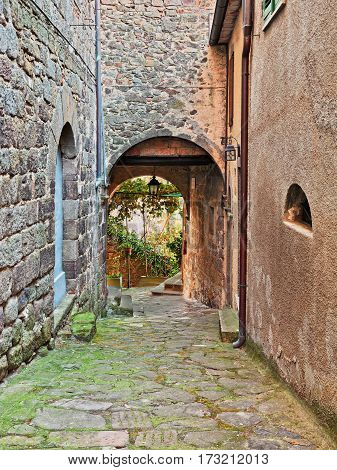 Arcidosso, Grosseto, Tuscany, Italy: old alley and underpass in the old town of the medieval tuscan village