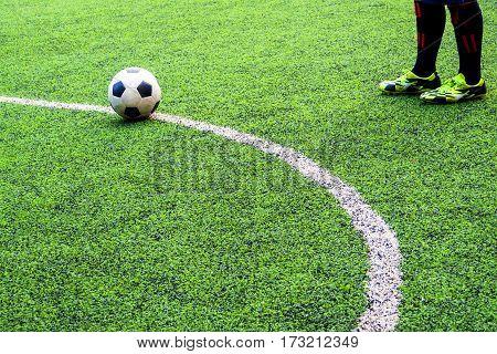 Footballer prep to shoot penalty , leg and shoe