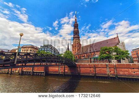 Historic St. Catherine's Church one of the five principal Lutheran churches with old bridge in Hamburg Germany