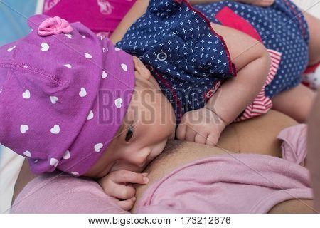 mother breastfeeding cute ner newborn, f;eeding newbrown