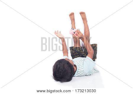 Cute asian boy lying play toy car on floor