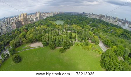 Cityscape with Sheep Meadow and The Lake in Central Park at summer day. Aerial view