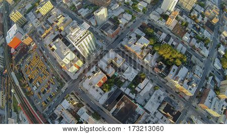 Urban sector with taxi parking near railway at summer morning. Aerial view