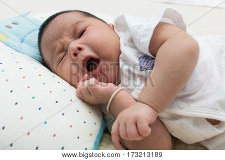 Cute asian girl little newborn lying and yawning