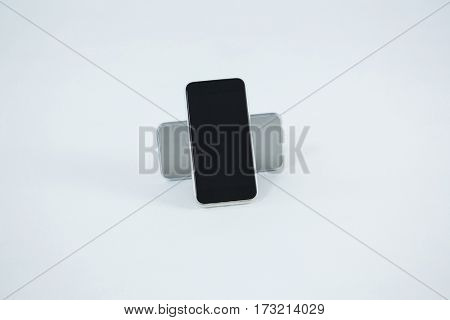 Close-up of mobile phones on white background