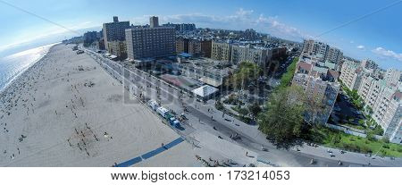 Townscape with many people get rest on Brighton Beach at summer sunny day. Aerial panorama