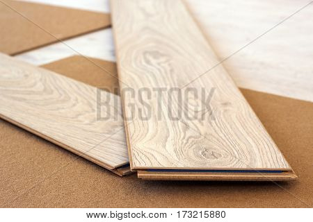 Laminate floor planks crossed renovation concept home