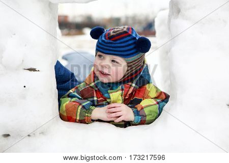 Child In Snow House