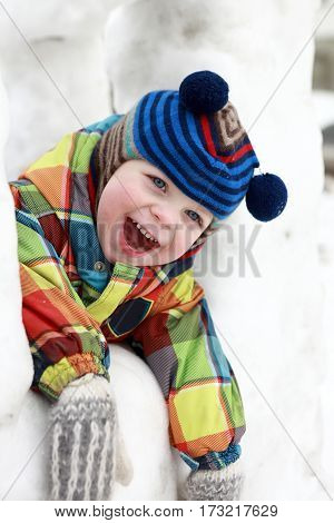 Kid In Snow House